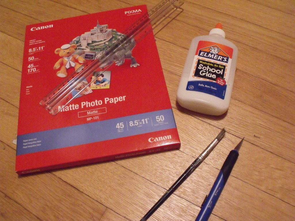 Photo paper, ruler, glue, brush, knife. Steady hands not included.
