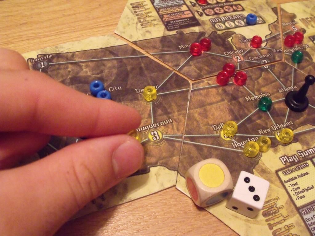 A yellow 3 adds a disease piece to Albuquerque